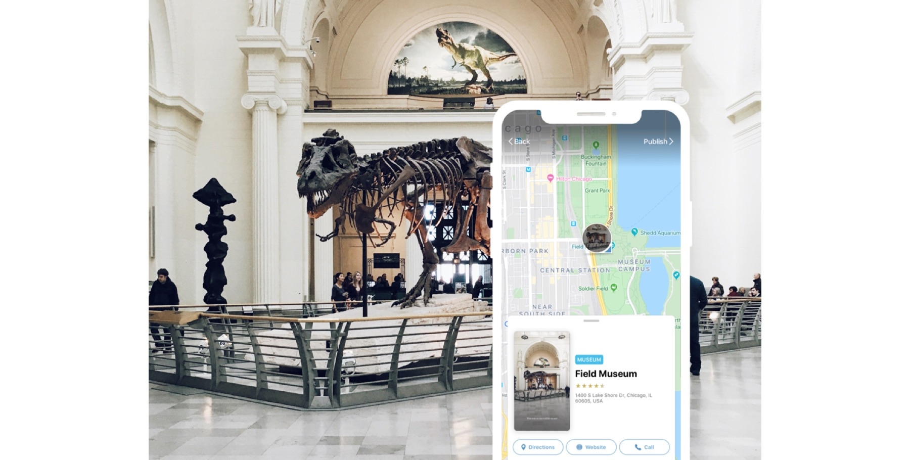 A dinosaur in a museum, in front of a phone showing a map of the museum location and name